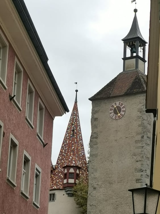 14th century Diebsturm (left) and 11th century Peterskirche am Schrannenplatz (right)